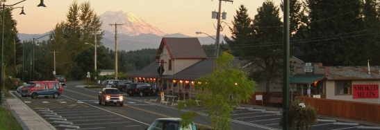 Black Diamond historic small businesses including the Black Diamond Bakery, with Mt. Rainier at sunset.