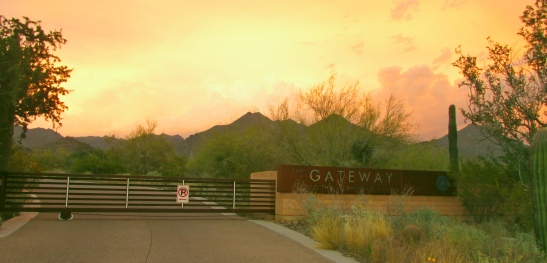 The Gateway Entrance to the McDowell Sonoran Preserve.  A bizarre photo - looking east at sunset! Thunderstorms in March, 2015 from a low pressure system over New Mexico created unusual lighting conditions.